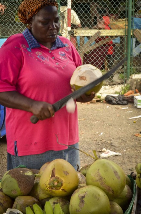 A lady, a machete and a coconut