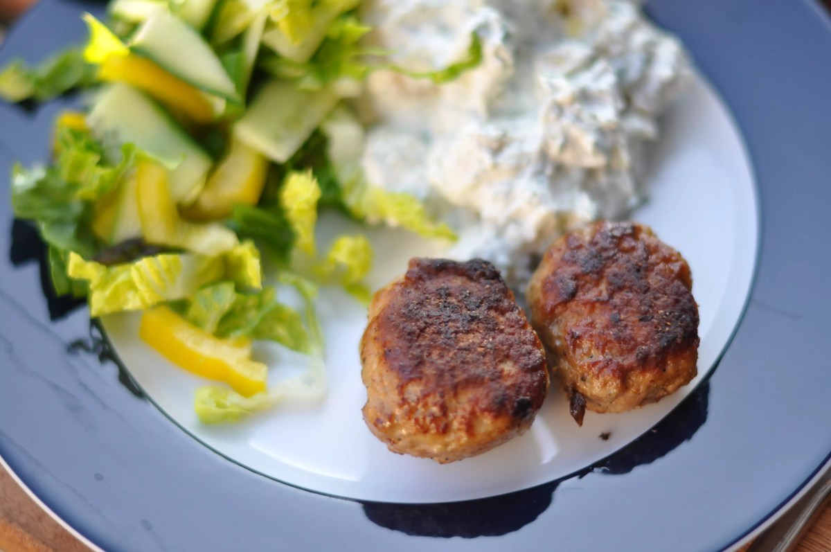 Fried Meatballs with veggie side dish and potato salad