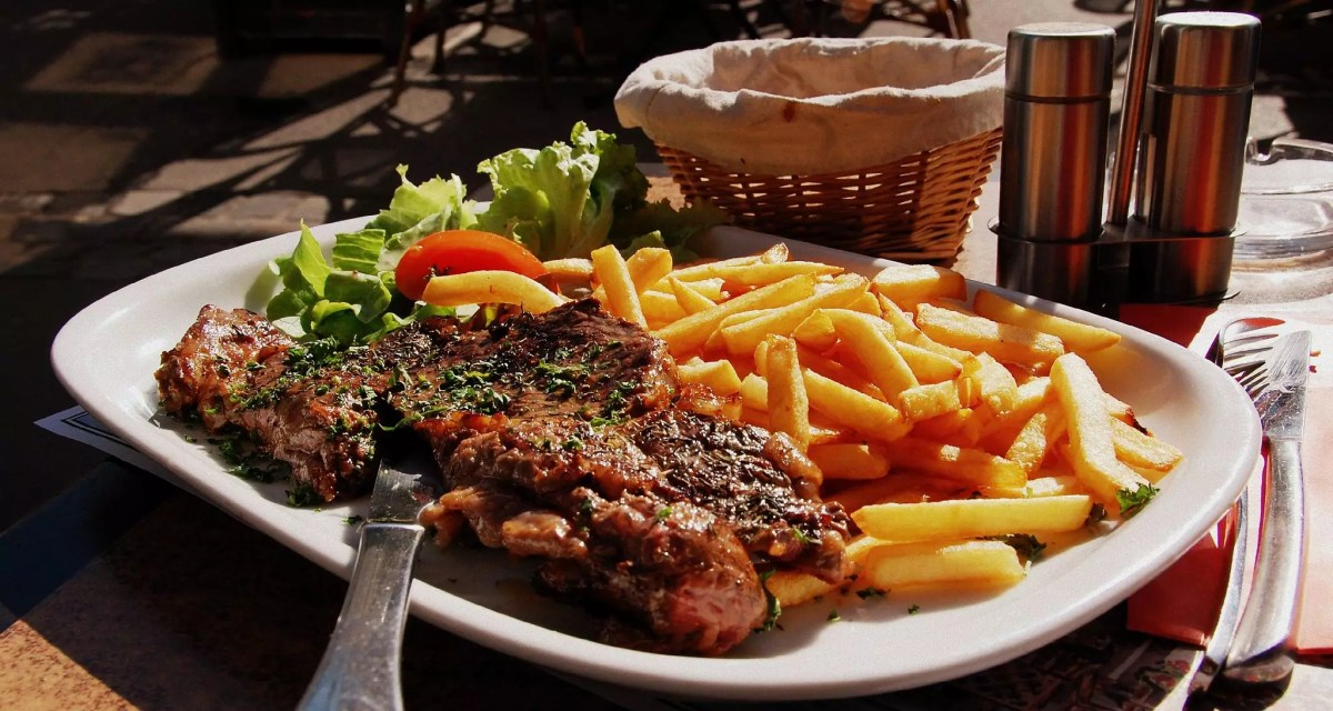 Delicious Destinations Paris - Combo of Steak and Fries with vegetable salad