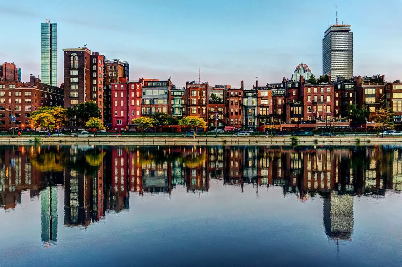 Brownstones of Boston's Back bay neighborhood reflected in the Charles River - photo by Robbie Shade under CC BY 2.0