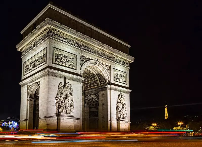 historical sites in Paris - Arc de Triomphe at night - photo by Sheila Sund under CC BY 2.0
