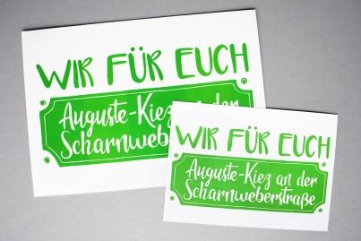 Logo auf Aufklebern für die Gewerbetreibenden im Auguste-Kiez an der Scharnweberstraße
