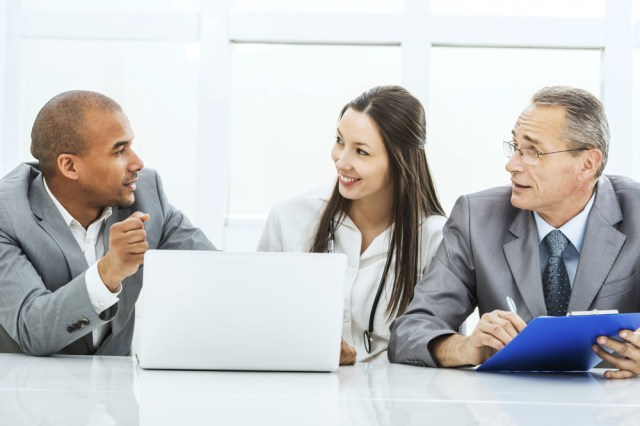 PAGE-8-Two-executives-meeting-with-female-doctor - Continuum Health