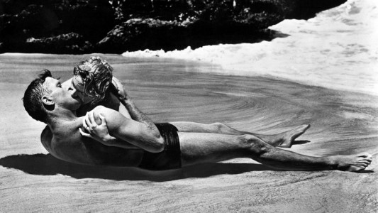 "Burt Lancaster and Deborah Kerr, shown here in a famous scene still from the 1953 Academy Award®-winning film ""From Here to Eternity,"" both received Oscar® nominations for their roles in the film.  Lancaster was nominated in the Best Actor category for his portrayal of Sgt. Milton Warden while Kerr received a Best Actress nomination for her role of ""Karen Holmes."" The film received 13 nominations in total and won eight Oscars® including Best Picture. Restored by Nick & jane for Dr. Macro's High Quality Movie Scans Website: http:www.doctormacro.com. Enjoy!"