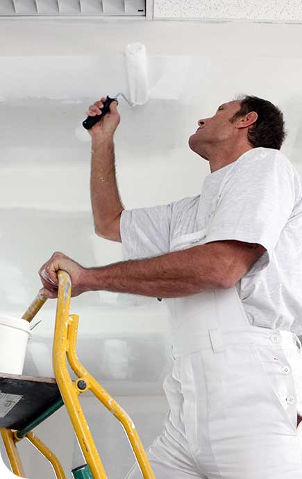 painting contractor with a roller brush