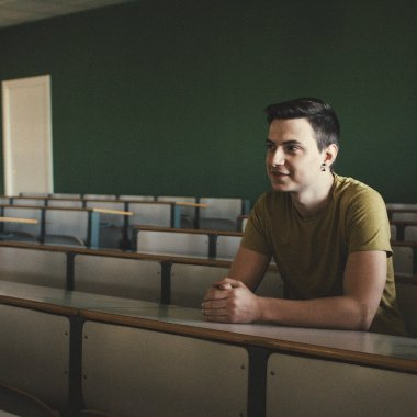 Man in a university classroom