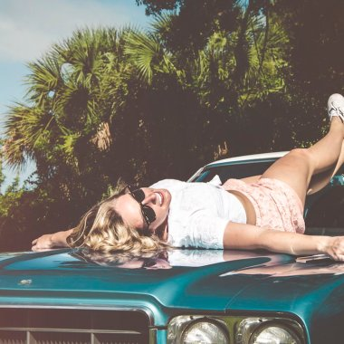 Women lying on car thinking about soul.