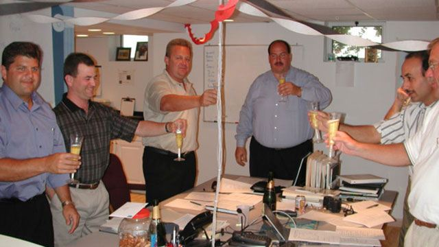 Convergint colleagues toasting to success in office header image