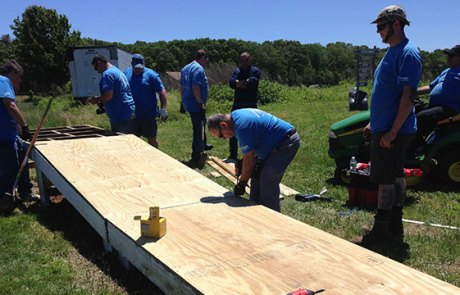Convergint Day New York colleagues building a wood ramp