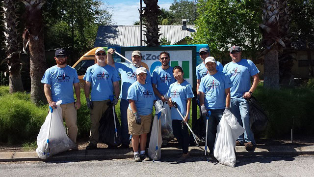 Convergint day Jacksonville colleagues picking up waste at a zoo header image