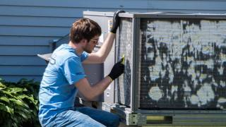 Convergint day male colleague cleaning air conditioner
