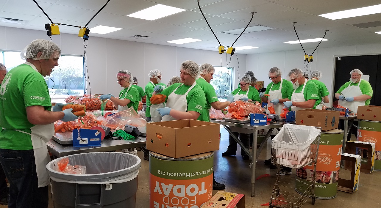 Colleagues preparing meals at a food bank