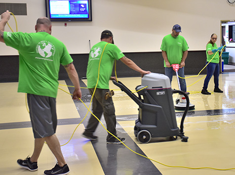 People cleaning a gym floor