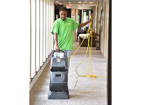 Man cleaning carpet