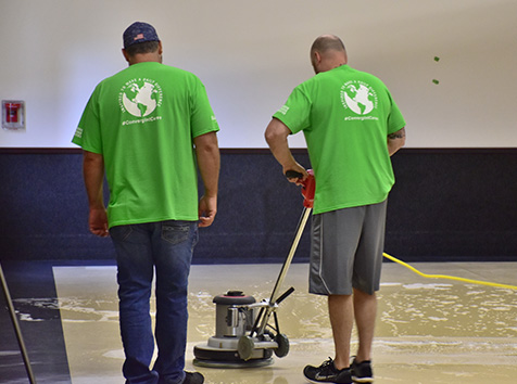 Men cleaning gym floor