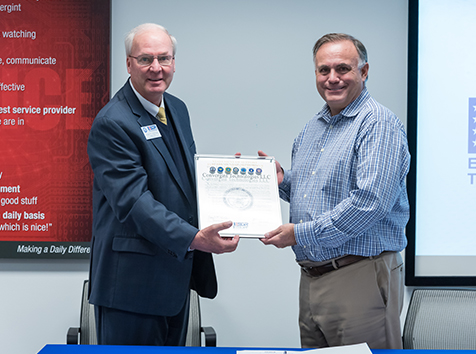 Convergint CEO Ken Lociatto posing with ESGR presenter