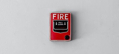 Fire alarm pull on wall