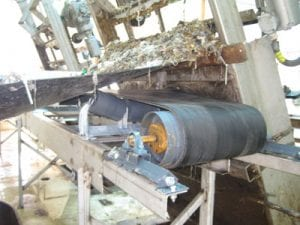 Conveyor system pulleys at wastewater treatment plant