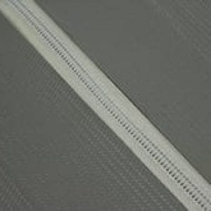 Closeup of spiral lacing holding two pieces of conveyor belting together