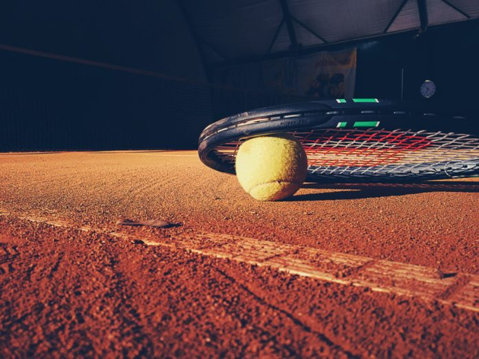 tennis ball racket clay court stock image