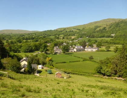 Rowen village with Tal y Fan mountain. Mixed woodland up to 800ft