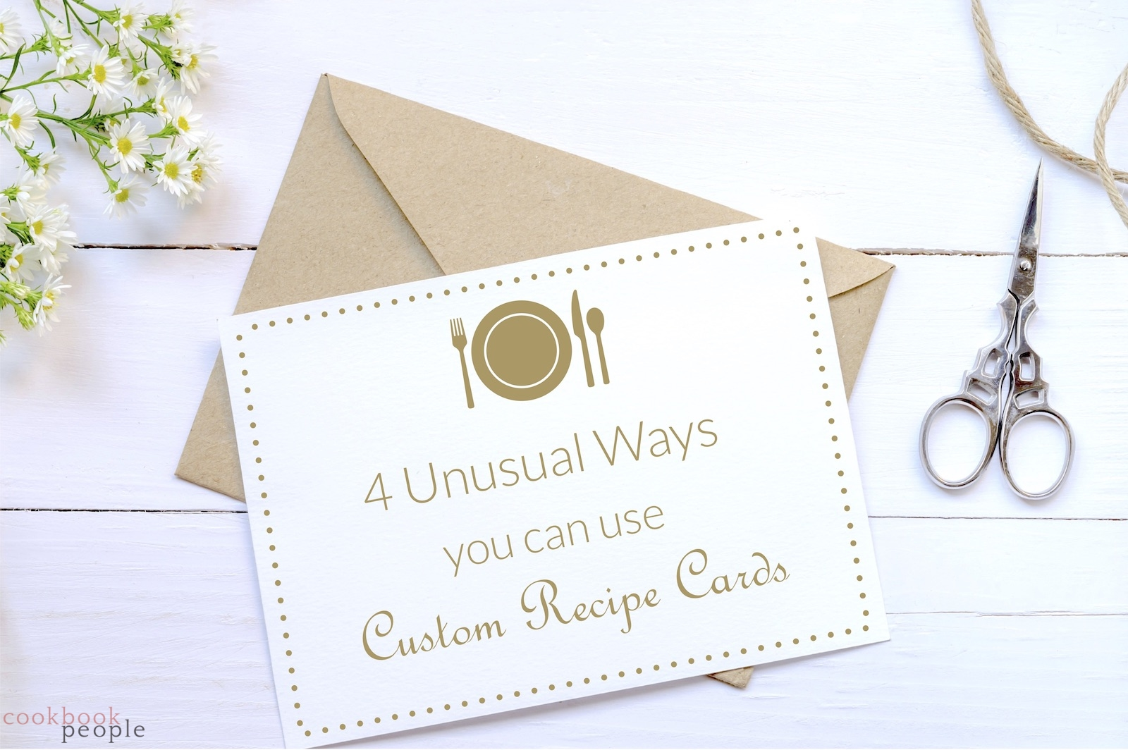 brown envelope, flowers, scissors and string with card featuring symbol of plate and cutlery and title: 4 Unusual Ways You Can Use Custom Recipe Cards