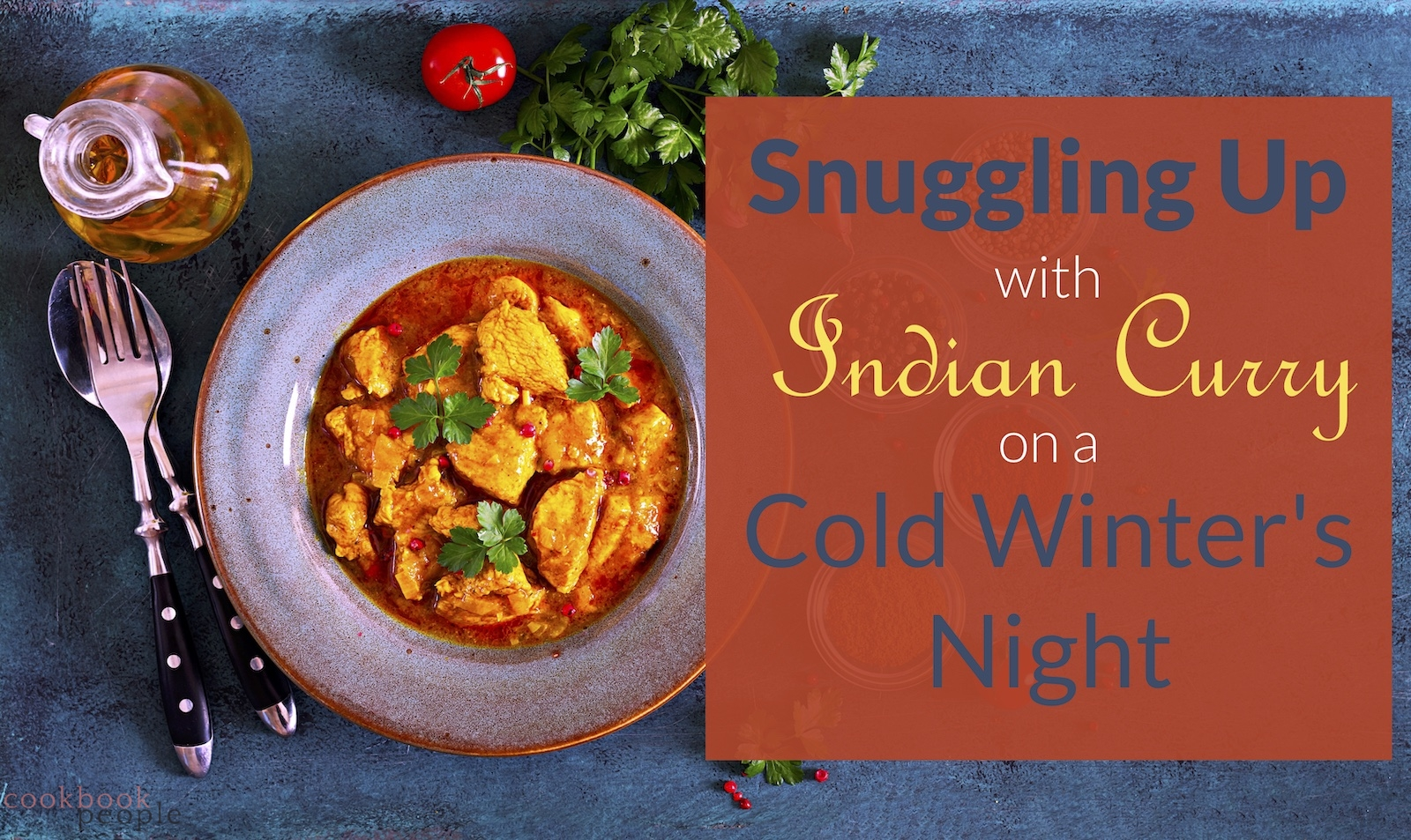 "Plate of chicken curry with tomato and coriander on blue bakckground overlaid with text ""Snuggling Up with Indian Curry on a Cold Winter's Night"""