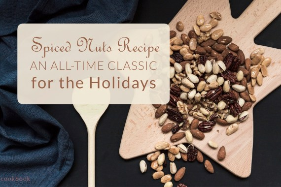 Assorted nuts on star-shaped chopping board with title: Spiced Nuts Recipe: An All-Time Classic For the Holidays