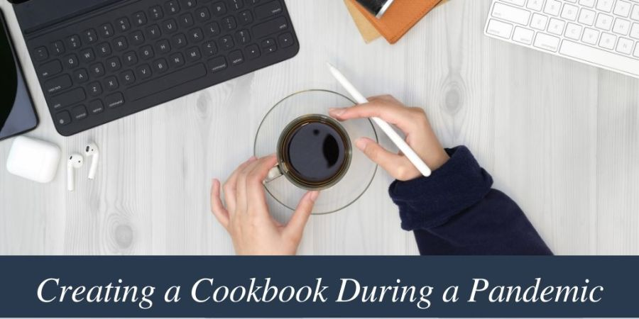 Sitting creating a cookbook during a pandemic for fundraising or as a holiday gift or to sell.