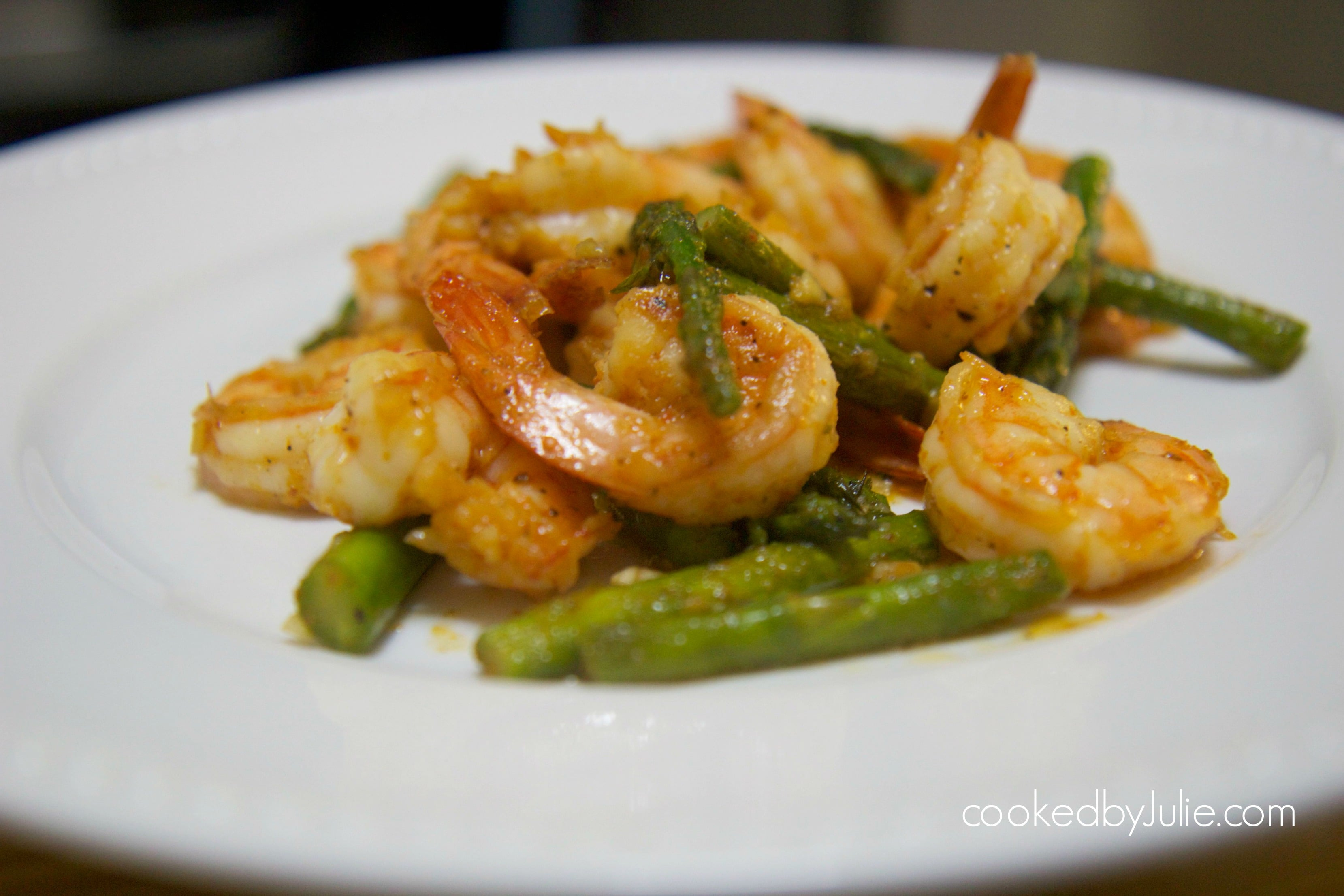 shrimp and asparagus on a white plate