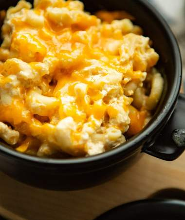 southern baked mac and cheese in a black pot.