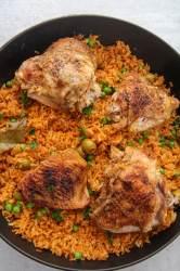 arroz con pollo in a black pot.