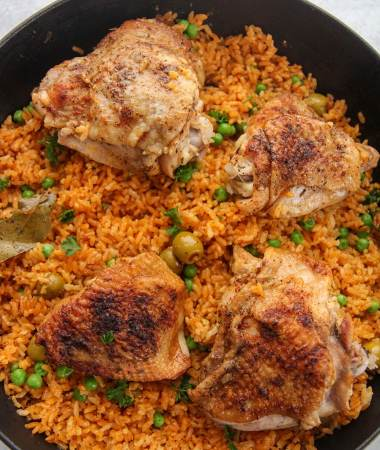 arroz con pollo in a black pot.