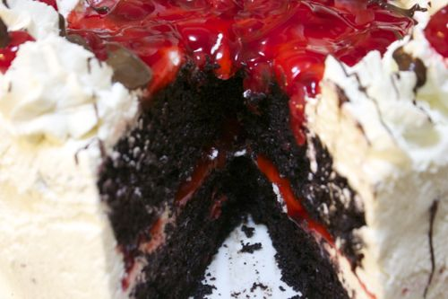 This black forest cake is filled with a delicious tart cherry filling and iced with a sweet vanilla buttercream