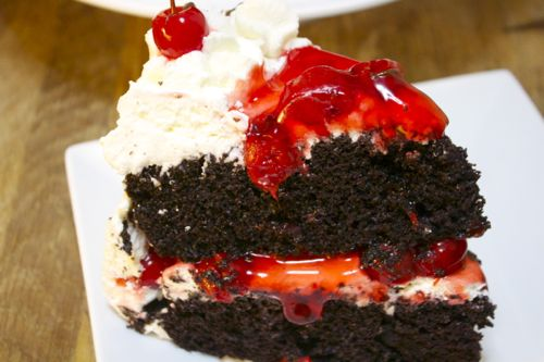 Moist chocolate cake filled with sweet vanilla frosting and tart cherries