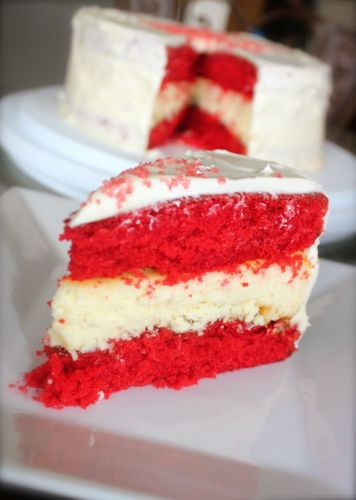 This red velvet cake has a layer of fluffy cheesecake and a creamy vanilla frosting
