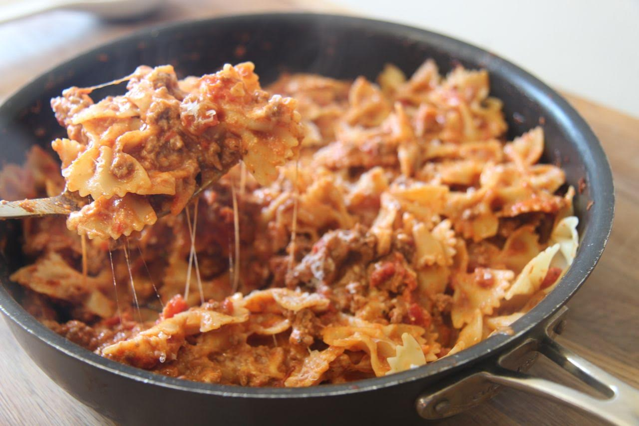 Bowtie pasta mixed with a spicy meat sauce and creamy cheese