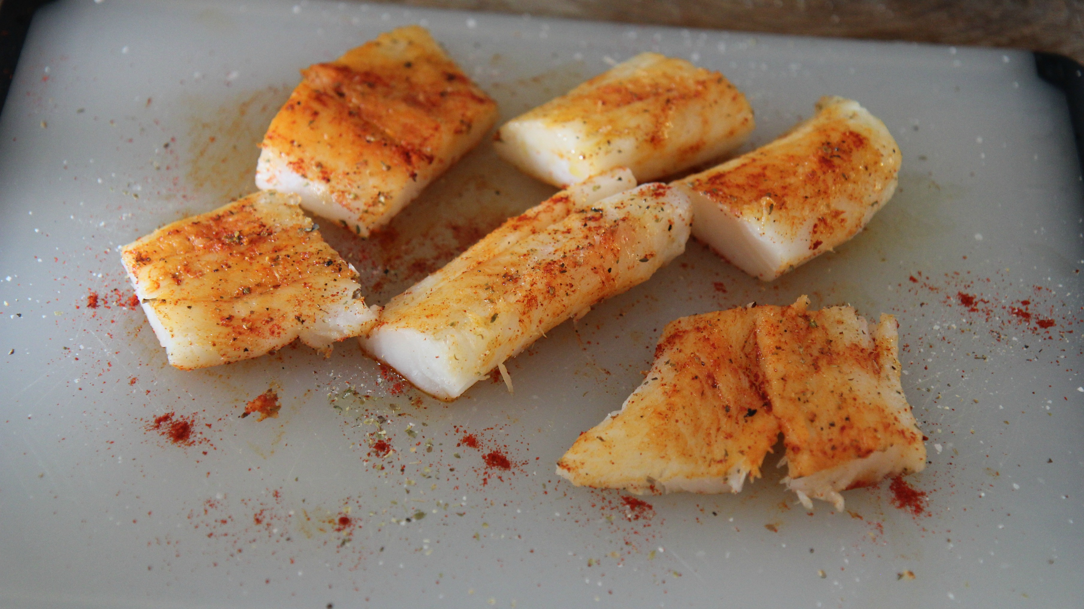 For this skillet cod dinner, you want to season your fish before cooking. Use a blend of spices you love, like chili powder for a little spice.