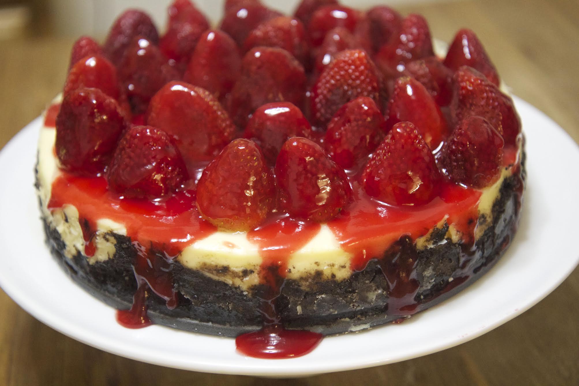 This homemade Oreo cheesecake is topped with fresh strawberries, making it the perfect dessert.