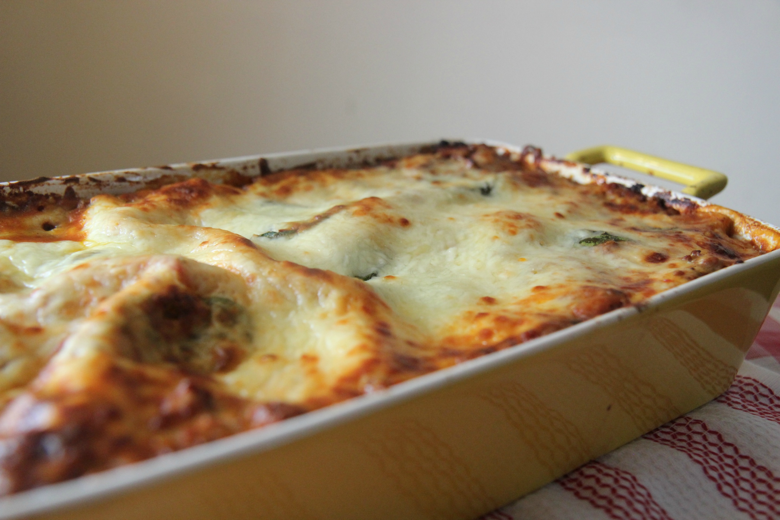 Looking for the best lasagna recipe? I made this with a bechamel sauce that is creamy and cheesy and the perfect addition to this recipe.