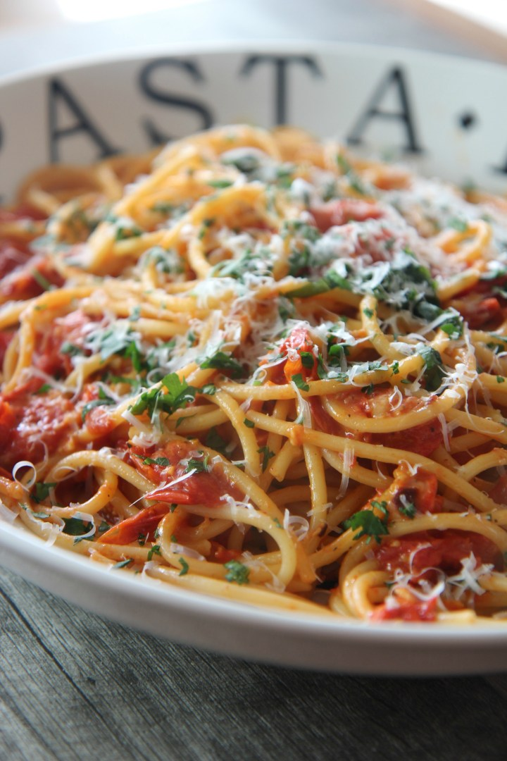 Fresh roasted tomatoes, tender pasta, and a light helping of mozzarella cheese make this a deliciously light pasta dish