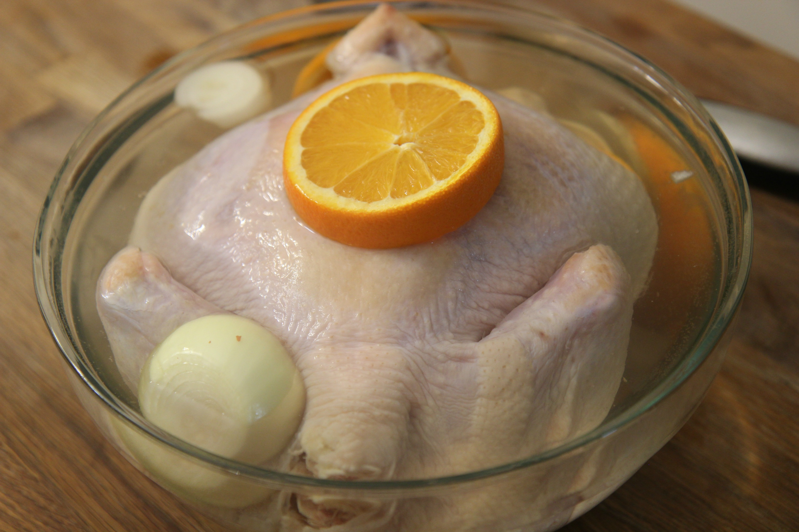 Brine the chicken in a mixture of water, salt and sugar with garlic, onions and oranges