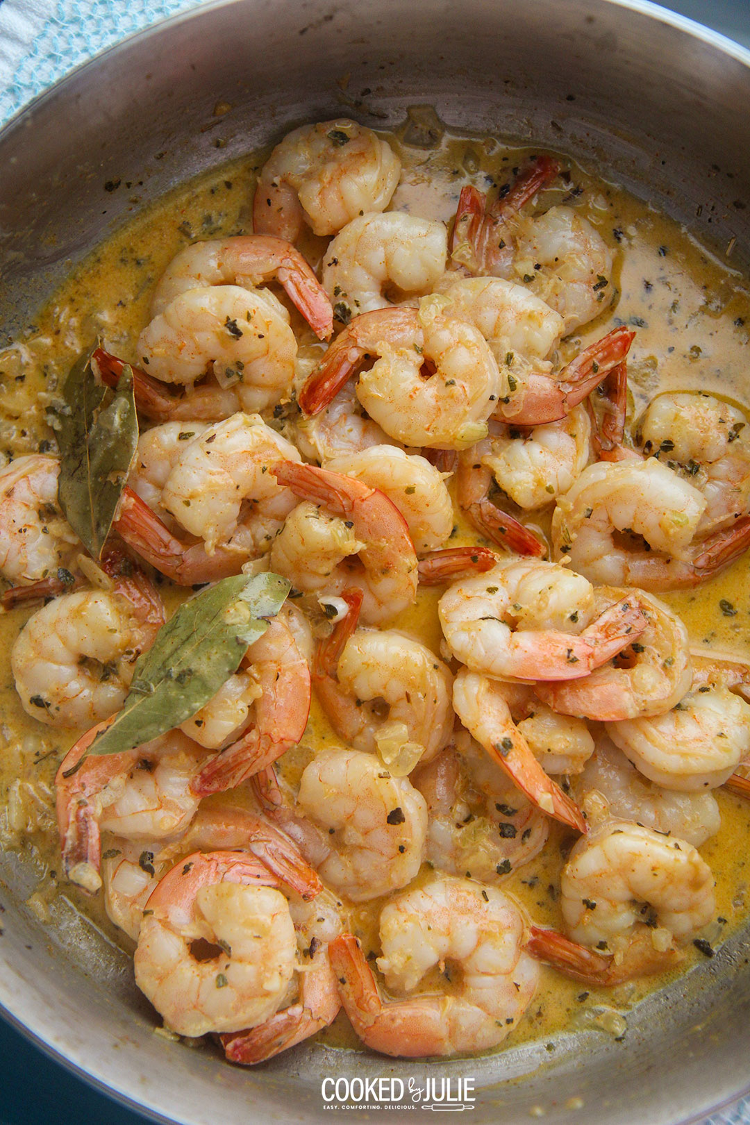 New Orleans creamy shrimp in a skillet.