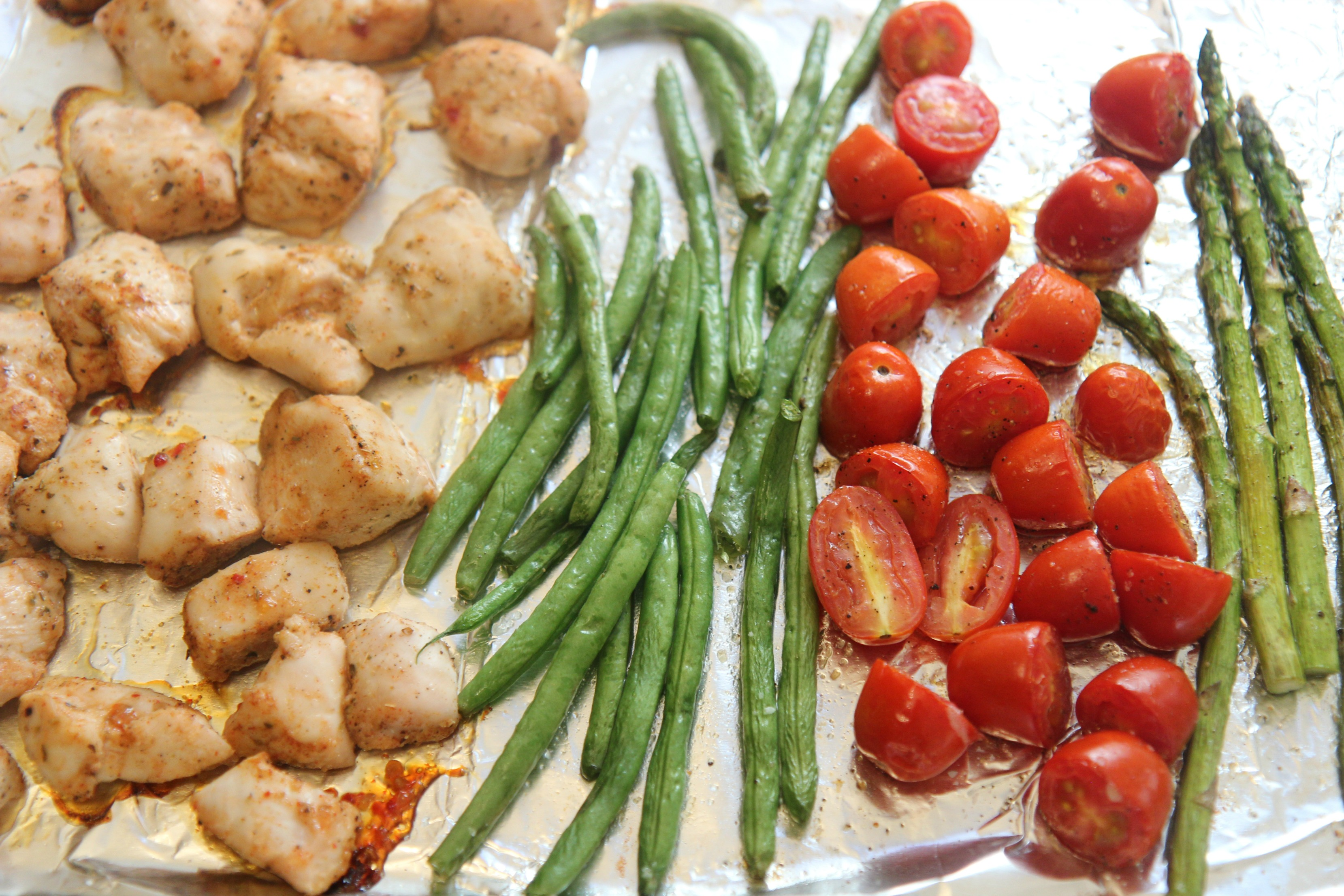 One Pan Chicken and Veggies - Seasoned chicken with green beans, asparagus, and cherry tomatoes.