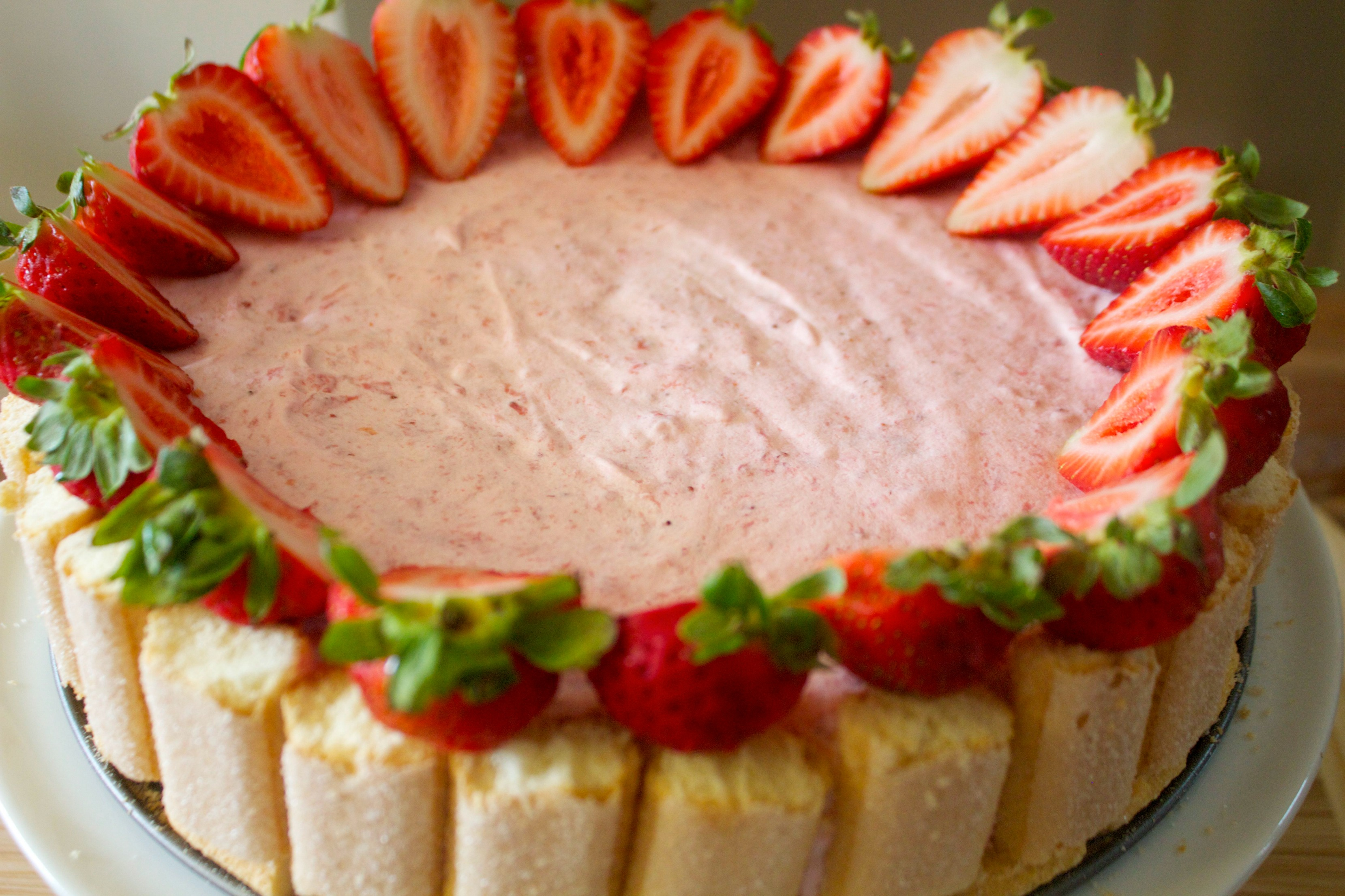 Lady fingers and fresh strawberries make this cake a star.