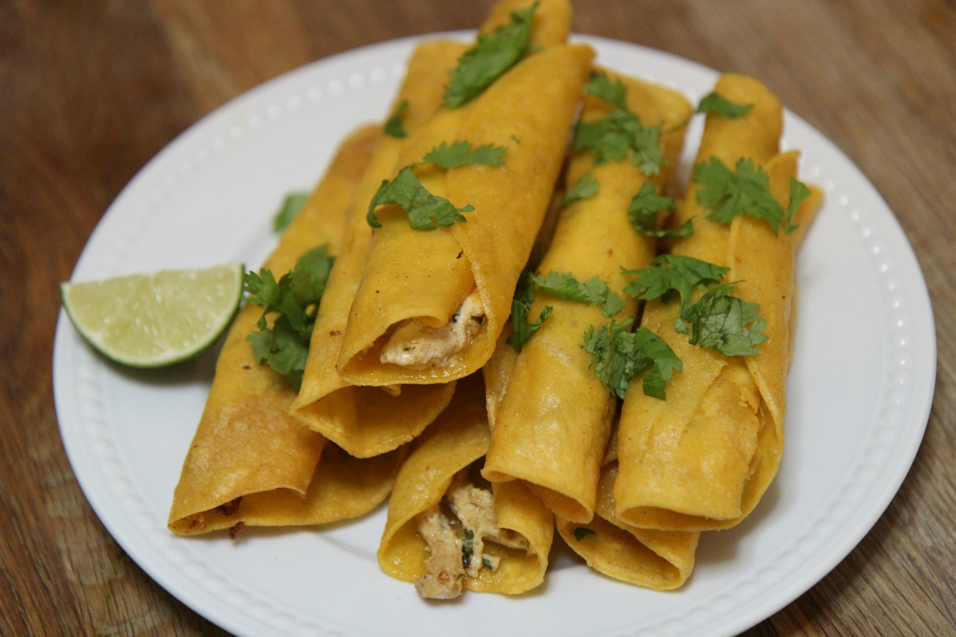 Seasoned chicken and cream cheese rolled inside corn tortillas and fried to crispy perfection