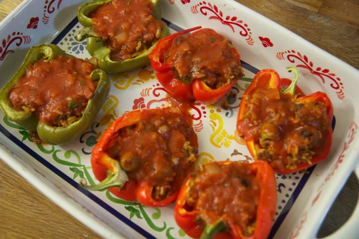 Cuban stuffed bell peppers filled with cuban picadillo filling