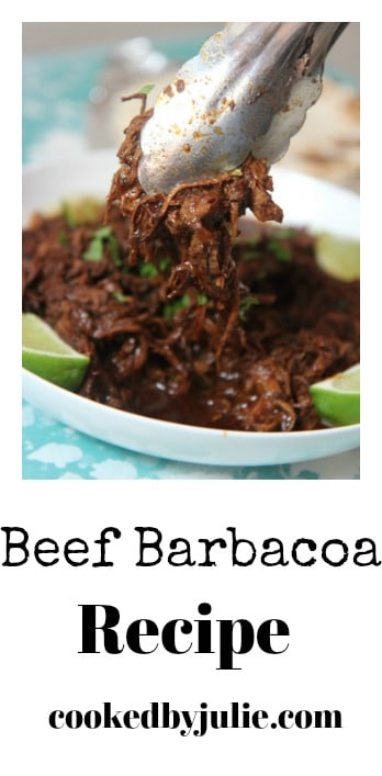 Barbacoa beef with lime wedges and cilantro