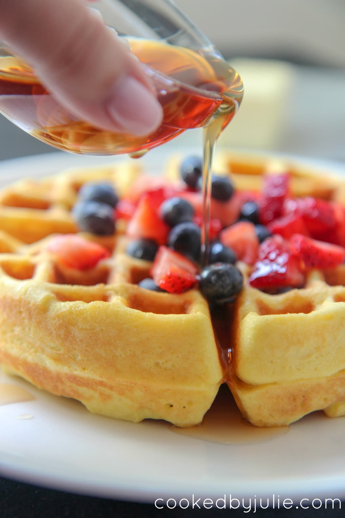 Keto waffles with syrup and fruit