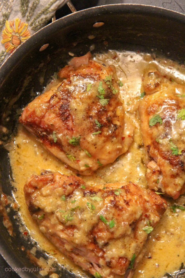 smothered chicken thighs with cream in a large pot